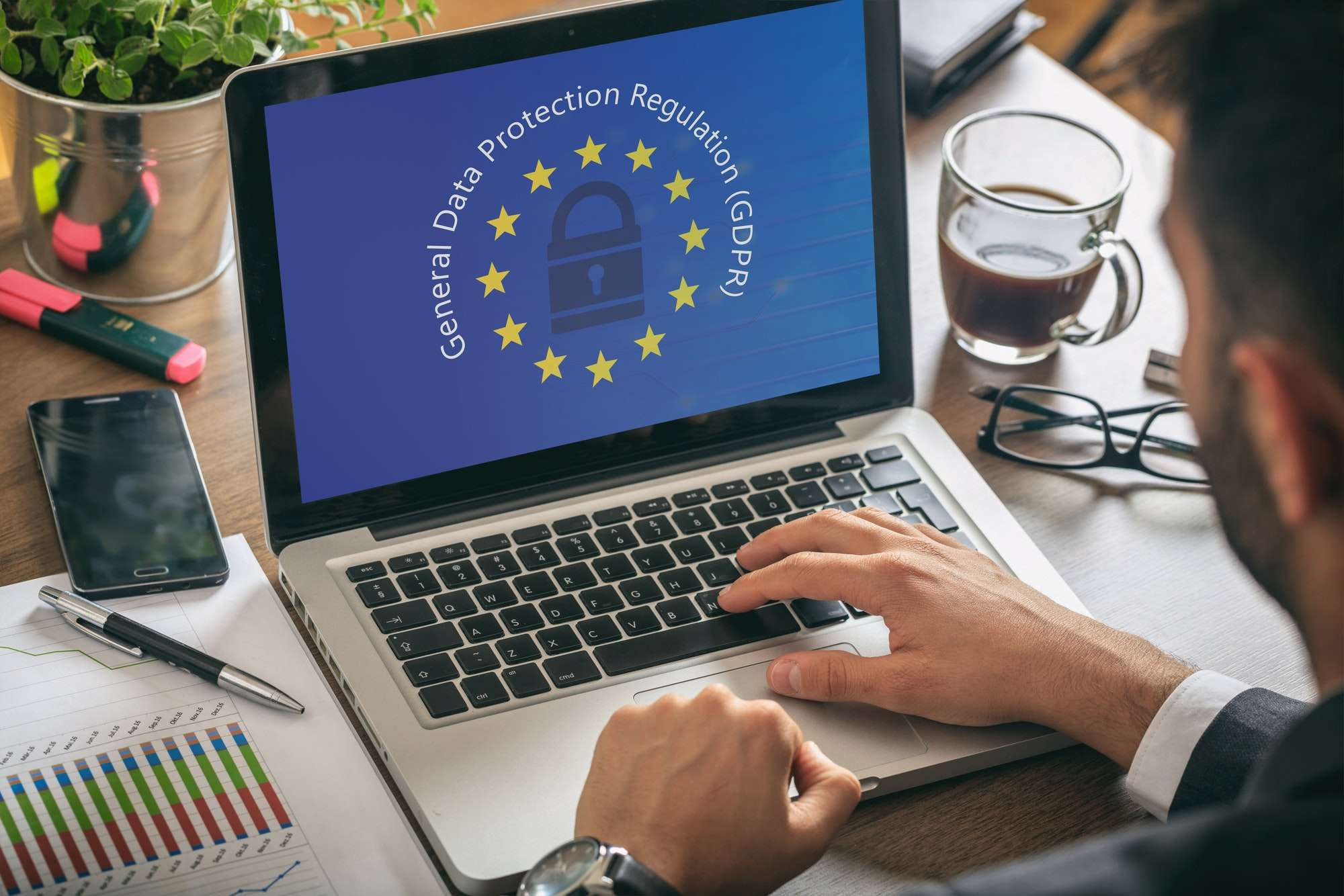man working with a computer general data protection regulation and european union flag